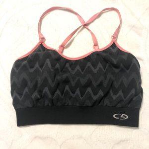 Supportive pad less sports bra w/ multi-way straps